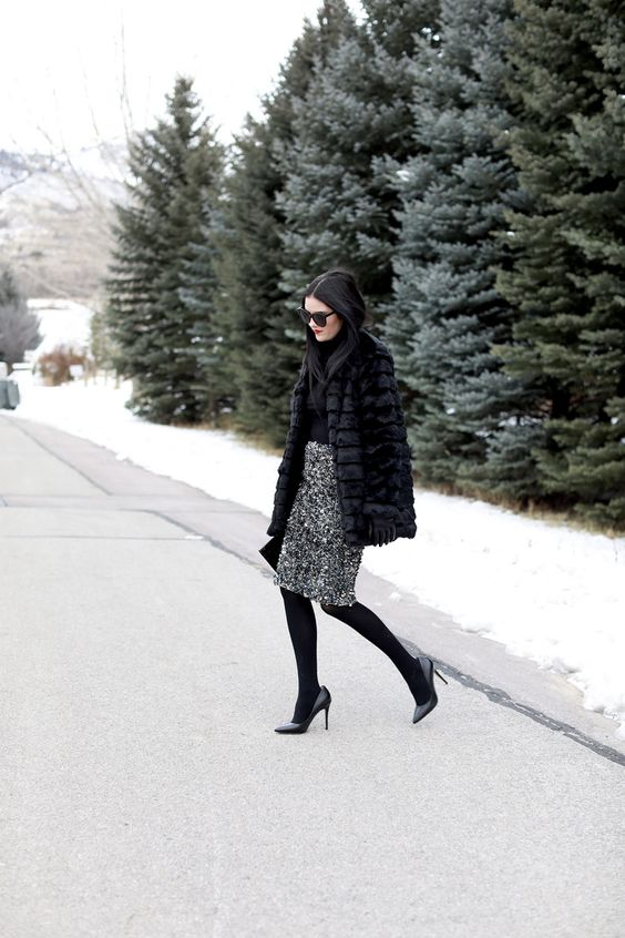 a black turtleneck, a silver sequin skirt, black tights and shoes and a faux fur coat
