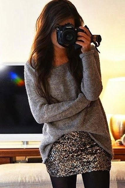 a simple grey sweater, a silver sequin mini skirt and black tights