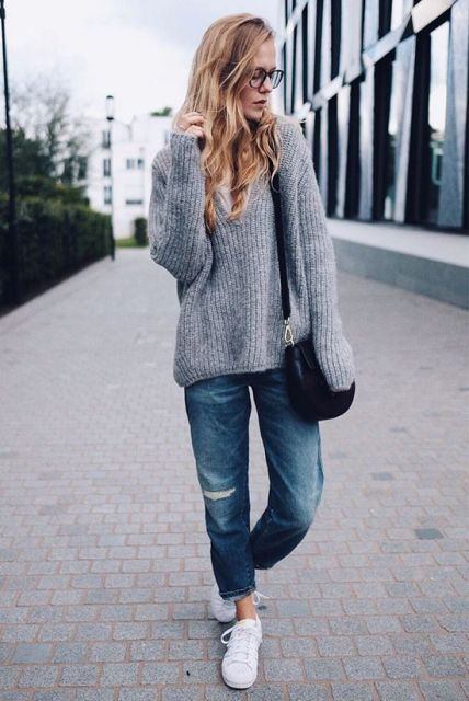 With gray oversized sweater, white sneakers and small bag