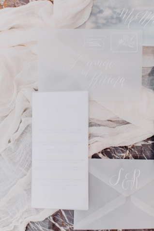 Transparent wedding invitations with white calligraphy