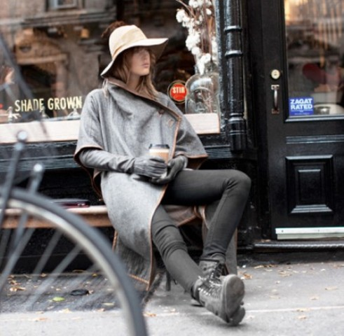 With gray coat, black pants, flat boots and wide brim hat