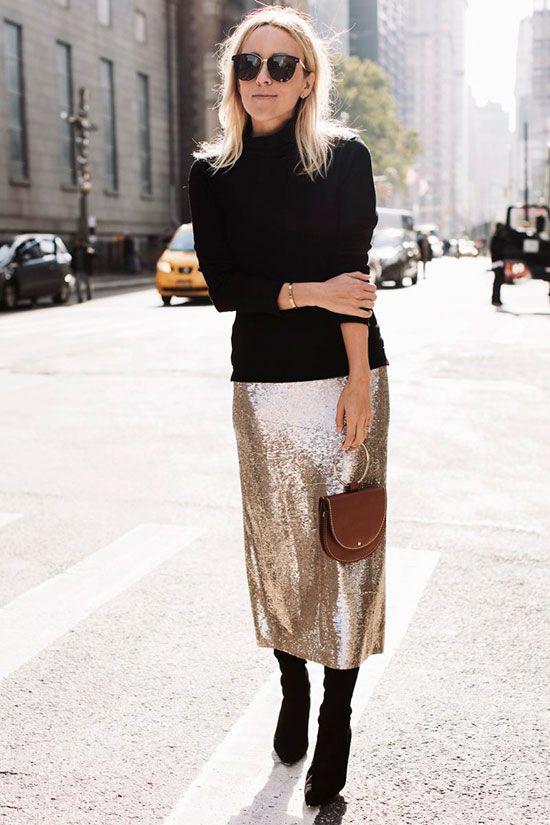 a black turtleneck, a champagne sequin midi skirt and black suede boots