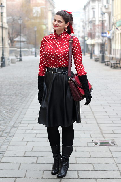 With printed blouse, leather skirt, red bag and black boots