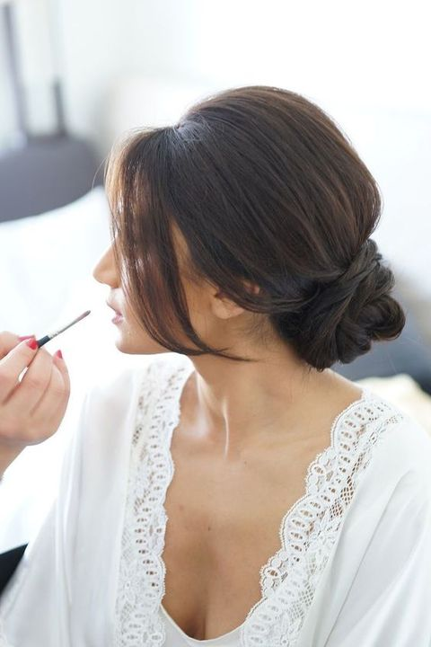 a twisted low bun with bangs will fit many bridal styles, and you can make it a couple of minutes