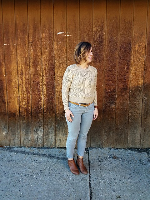 With beige sweater and brown boots