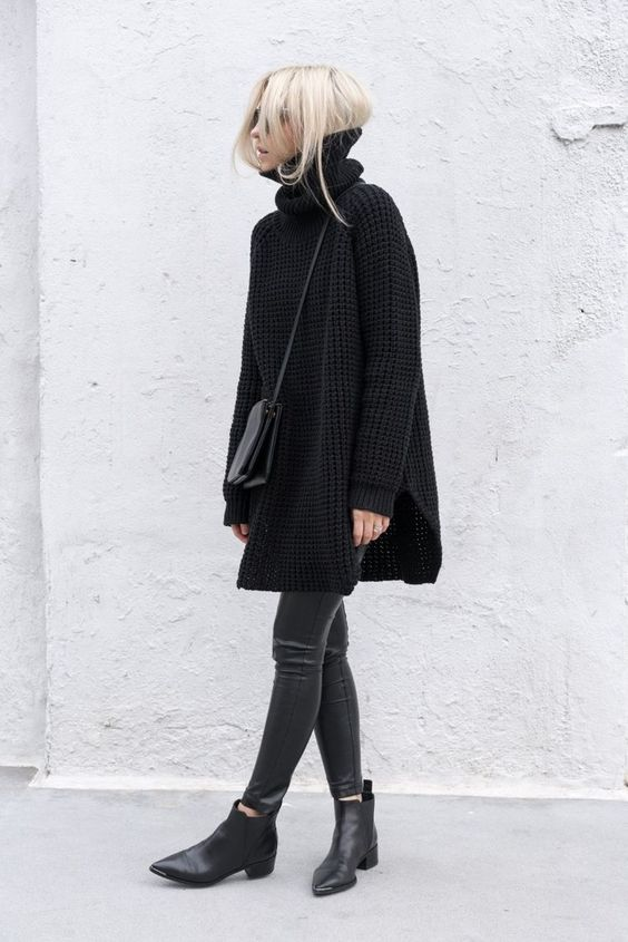 a black oversized sweater, black leather leggings, black booties and a black bag