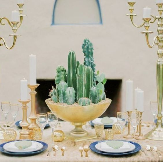 a tall gilded bowl with cacti is a chic idea for a desert-inspired wedding