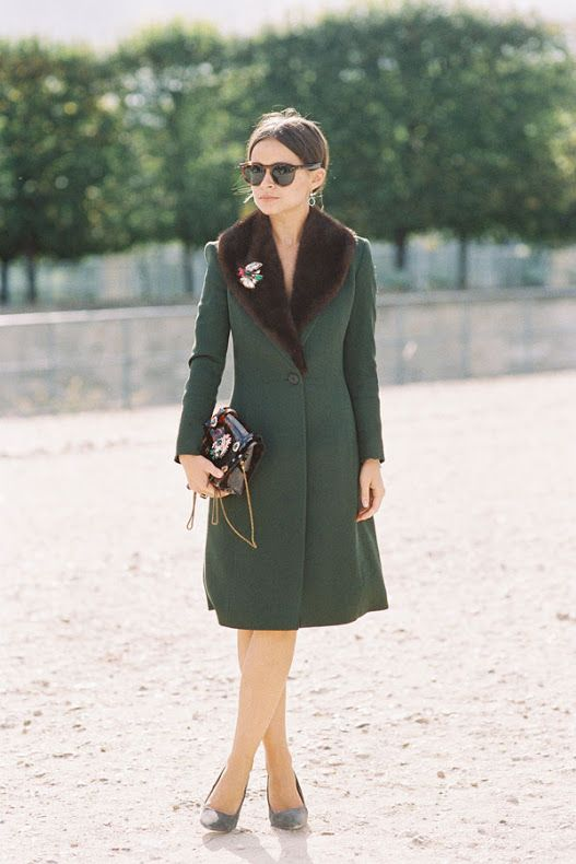 a vintage-style emerald coat with a brown faux fur stole and a brooch looks wow