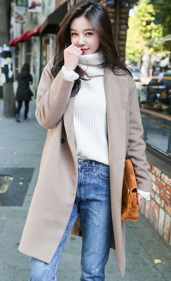 blue ripped jeans, a white turtleneck sweater, a blush coat for a cozy feel