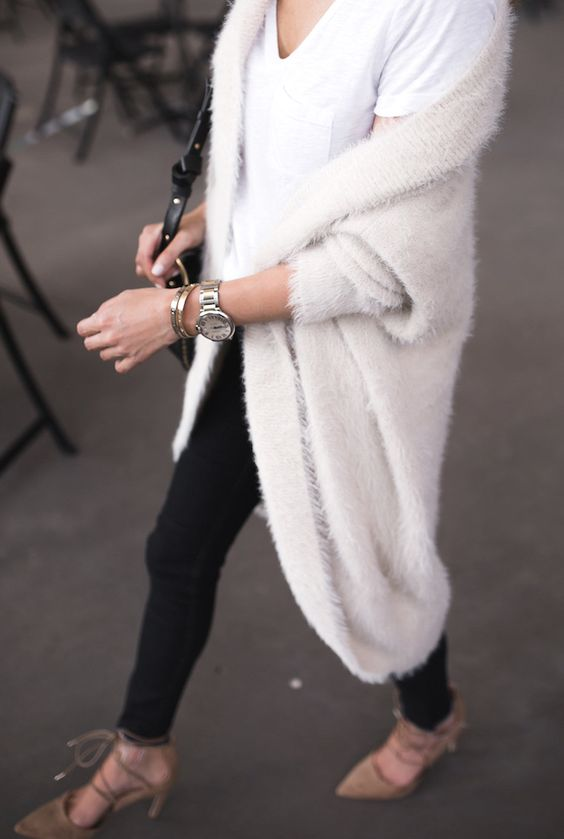 black jeans, a white tee, lace up shoes and a white long angora cardigan