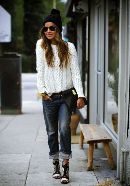 With white sweater, printed cutout boots, clutch and beanie
