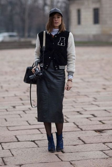 With black midi skirt, navy blue boots, cap, mini bag and white turtleneck