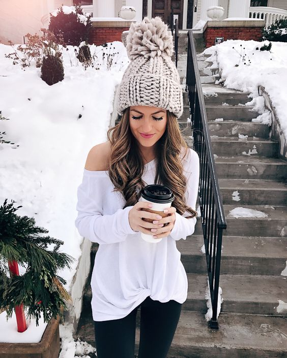 a cute light grey oversized beanie with a large pompom to make a statement