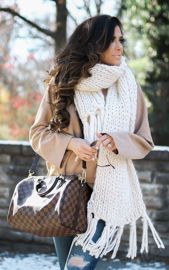 a creamy chunky knit scarf over a short camel coat for a stylish look