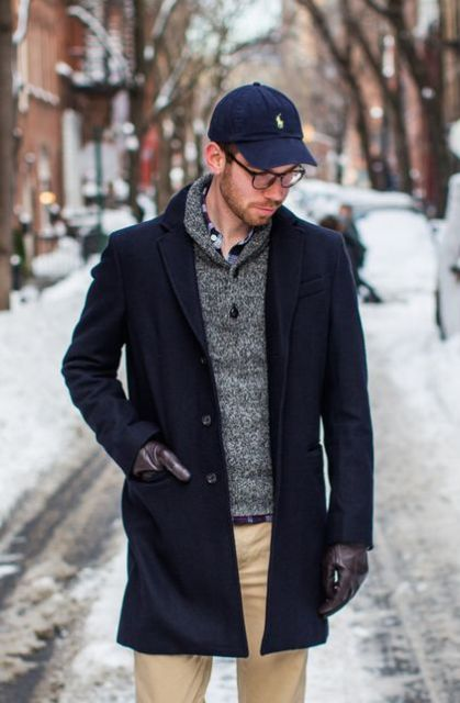 With gray sweater, beige trousers and navy blue coat