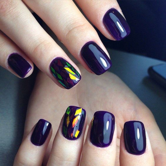 deep violet nails with holographic accents for those who love geometry