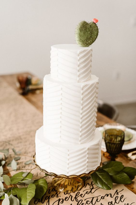 a textural chevron wedding cake with a cactus on top is ideal for a desert wedding