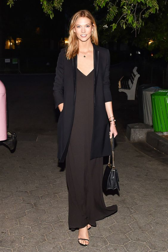 a minimal black slip dress with a long blazer and strappy sandals