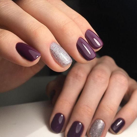 purple manicure with silver glitter accent nails look very chic