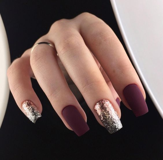 matte burgundy nails and gold glitter ones look very eye-catching and unusual