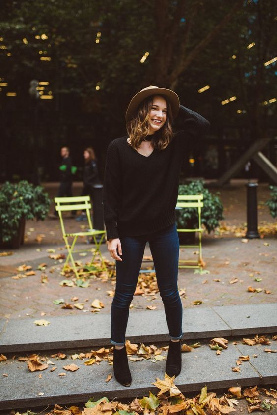 a black chunky kit sweater, navy jeans and black suede boots