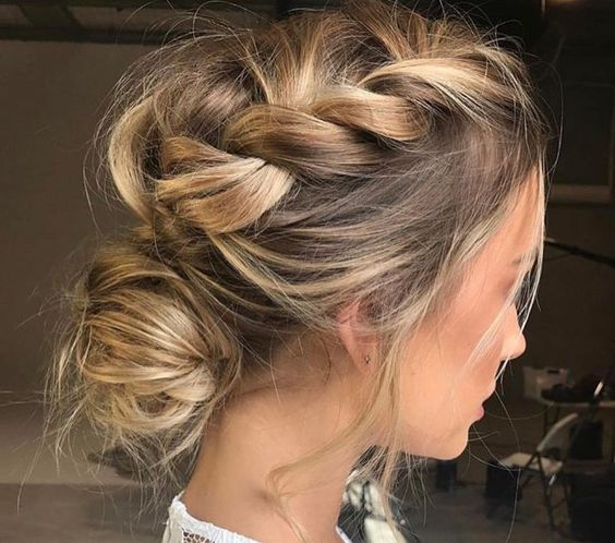 a messy braided updo with a low bun looks casual and will do for any party