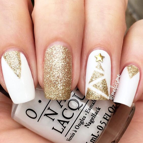 white and gold glitter nails with a Christmas tree and geometric details