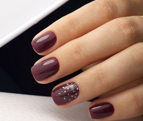 burgundy manicure with silver glitter and rhinestones for a gorgeous touch