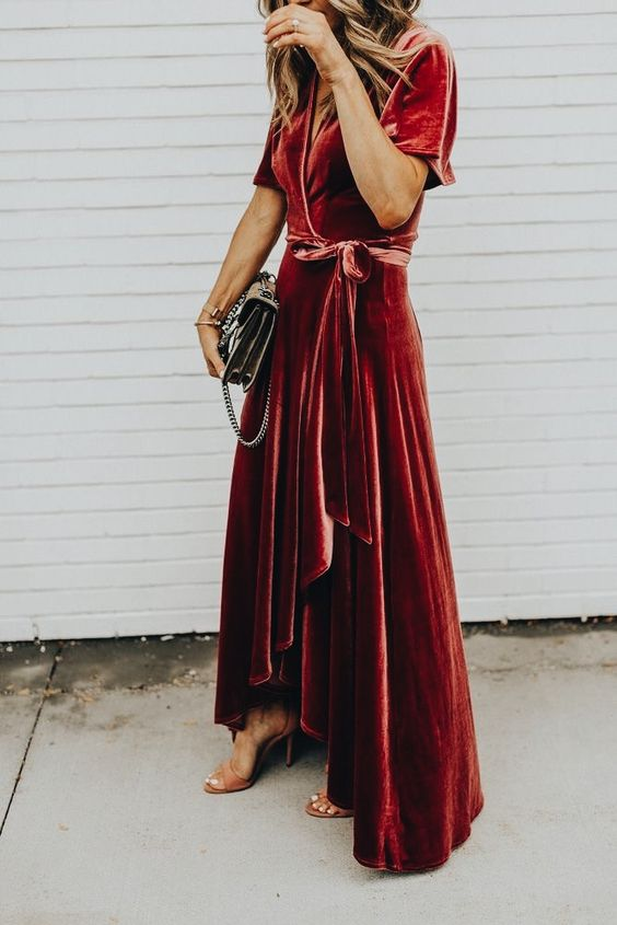 a red velvet wrap dress with a high low skirt and a V-neckline plus short sleeves