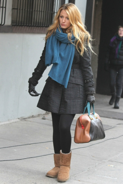 With dark gray coat, blue scarf, black tights and leather bag