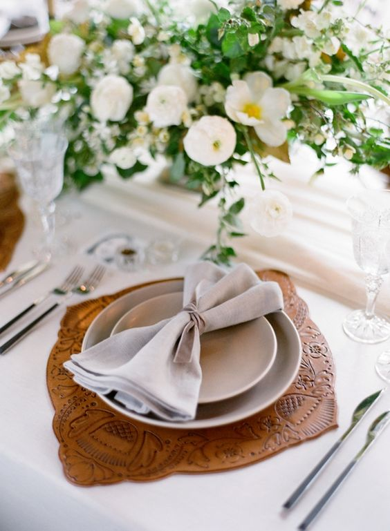 a stamped leather placemat for a chic textural touch to make the place setting cooler