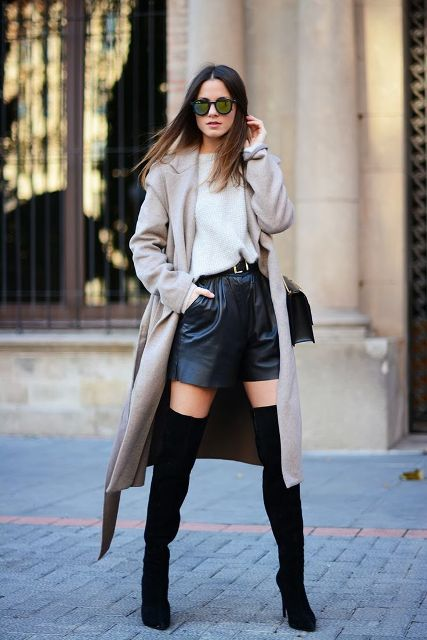 With loose shirt, beige coat and black suede over the knee boots