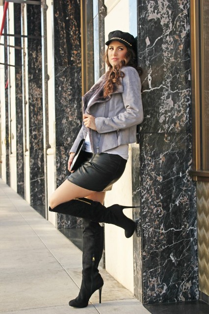 With jacket, leather mini skirt and high heeled boots