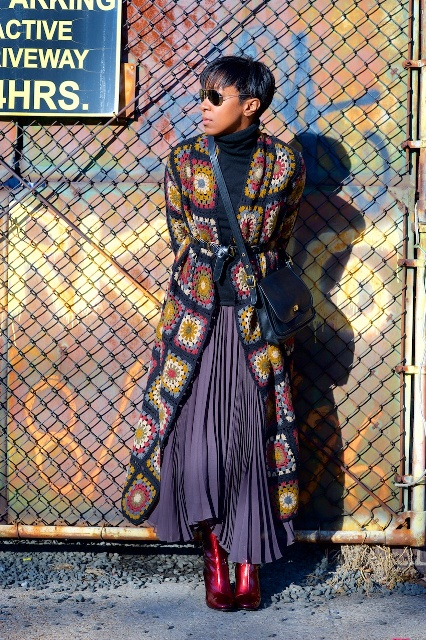 With turtleneck, pleated maxi skirt, printed coat and crossbody bag