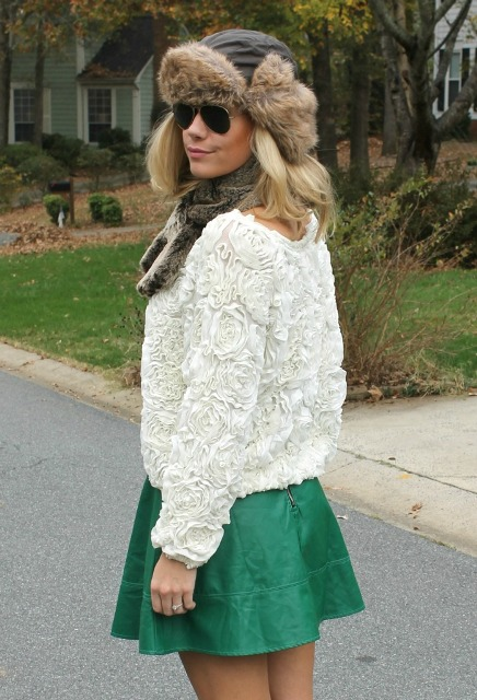 With white sweatshirt and green skirt