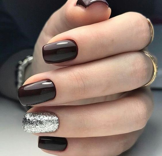 elegant black cherry nails with a silver glitter accent look very chic