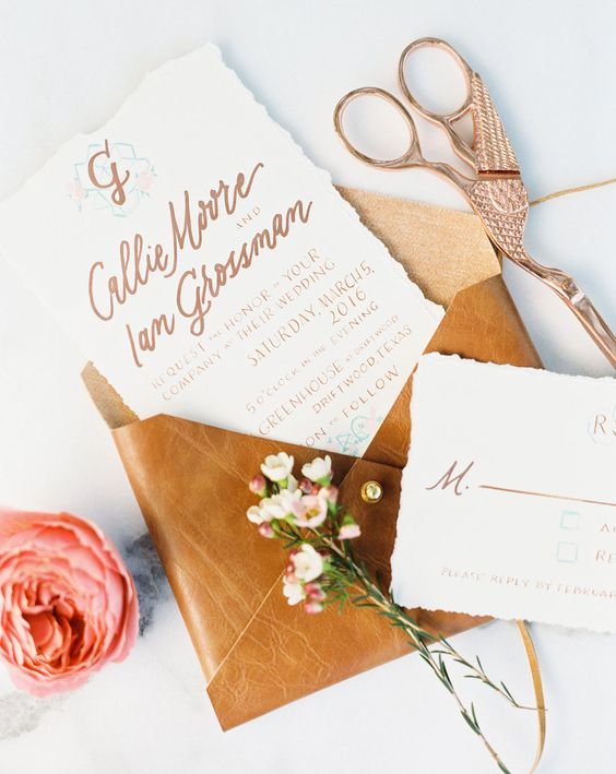 a leather and rhinestone envelope for cool wedding invtiations