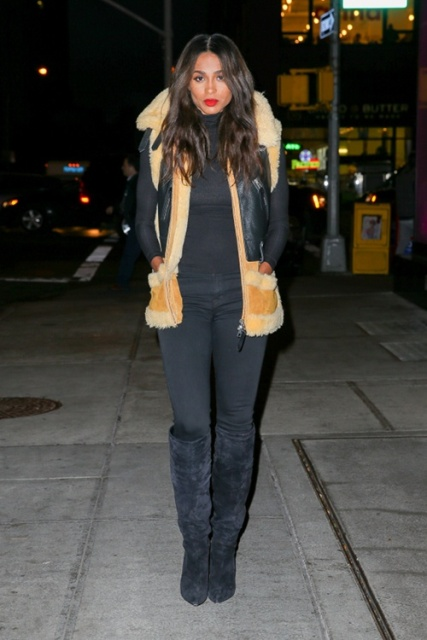 With black turtleneck, pants and suede high boots