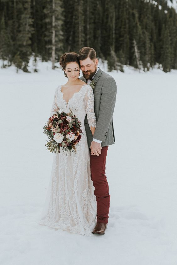 a boho lace long sleeve wedding dress with a deep V-neckline looks chic and refined