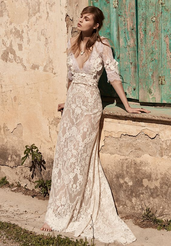 a champagne lace and lace applique wedding dress with a deep neckline and long sleeves for a boho bride