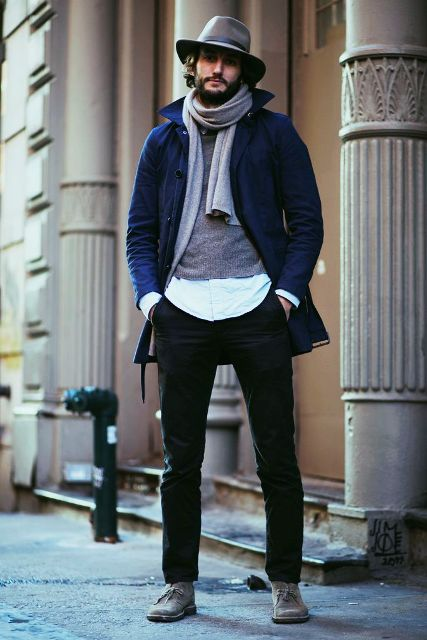 With white shirt, gray sweater, navy blue coat, gray scarf, felt hat and black pants