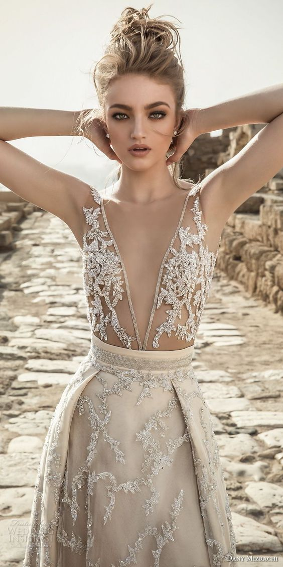 a champagne wedding gown with sparkling embroidery and an illusion bodice, a plunging neckline