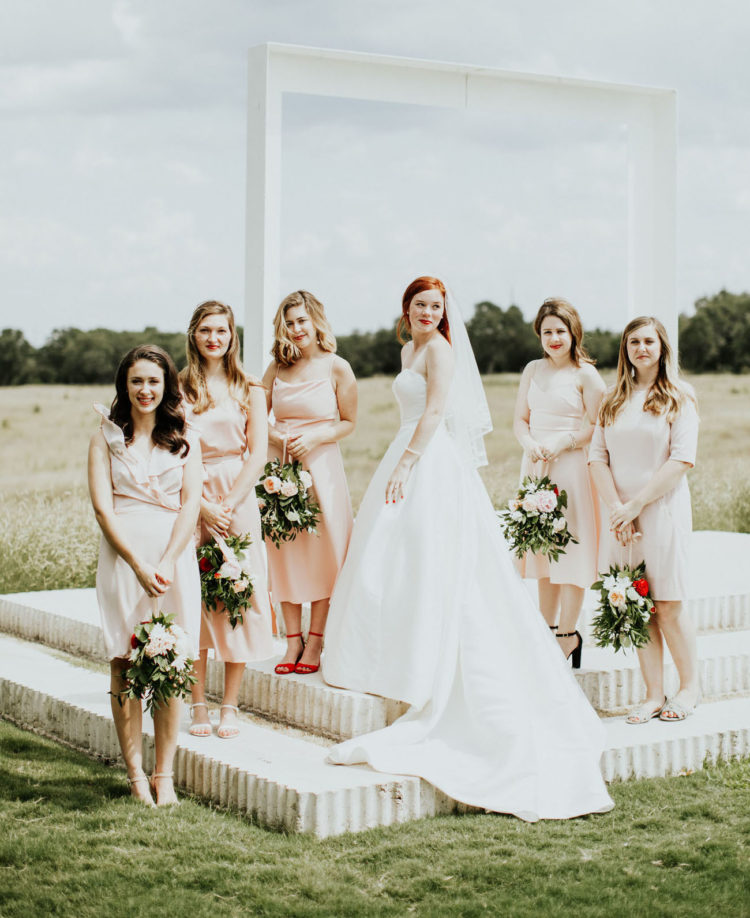 The bridesmaids were rocking mismatching blush gowns