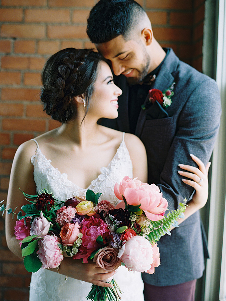 This artsy industrial wedding will convince you to go all-modern for your big day! #abstractwedding #weddinginspo #industrialwedding see more: https://ruffledblog.com/modern-texas-wedding-jewel-tones
