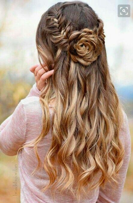 a whimsy fishtail braid and rose half updo with wavy hair down