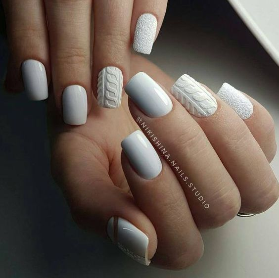white cable knit and textural nails look very comfy in winter