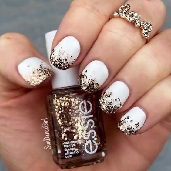 white nails with gold glitter hexagons for a chic glam look