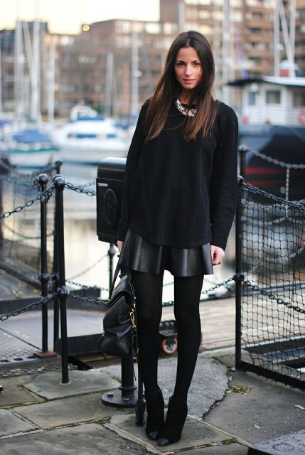 With oversized shirt, ankle boots and black bag
