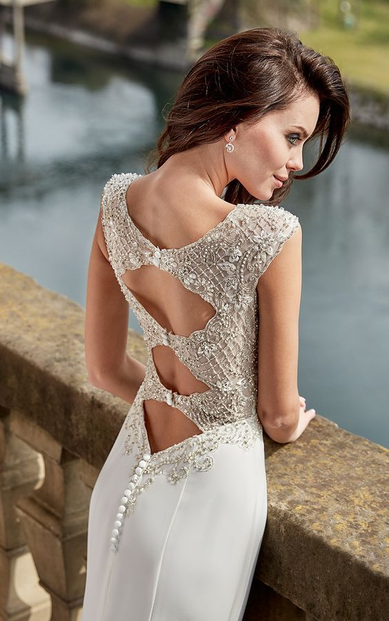 a heavily embellished cutout back on buttons looks wow