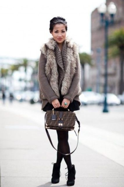 a brown sweater, a faux fur vest, a black mini and black suede booties